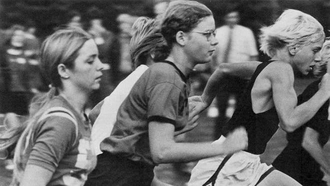 """Junior Mary Friederichs """"takes advantage of the new law passed stating that girls can participate in boys' sports,"""" states the 1974 Technical High School annual."""