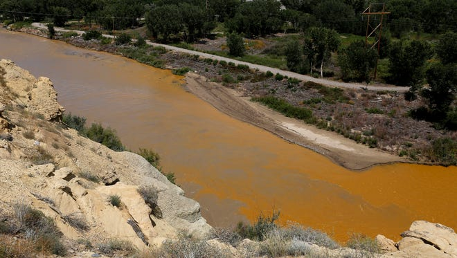 Water from the Animas River mixes with the San Juan River on Aug. 8, 2015, shortly after the Gold King Mine spill, as seen in this file photo.