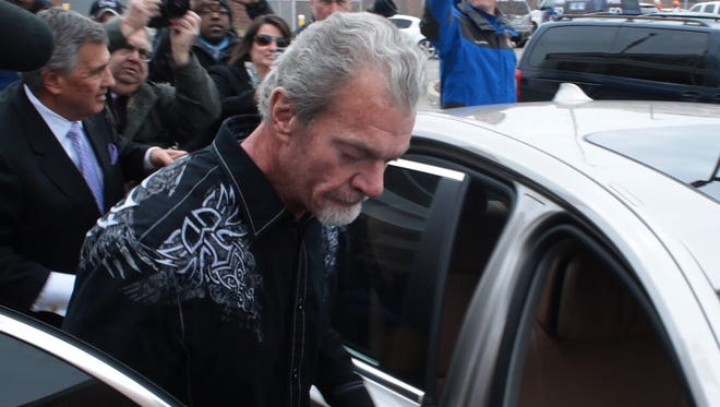 Jim Irsay, owner of the Indianapolis Colts, exited a Noblesville detention facility on March 17, 2014, the day after he was arrested on felony counts related to impaired driving in Carmel.