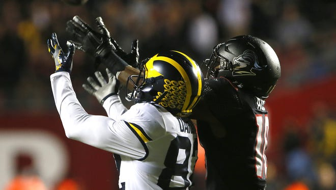 Michigan Wolverines wide receiver Amara Darboh (82) makes a catch against Rutgers Scarlet Knights defensive back Blessuan Austin (10)  during first half at High Point Solution Stadium,Piscataway,NJ. Saturday, October 8, 2016. Noah K. Murray-Correspondent/Asbury Park Press Michigan vs. Rutgers football