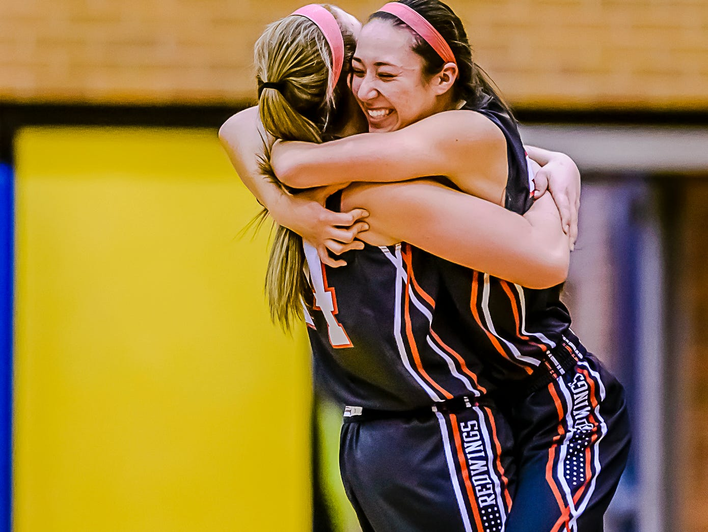 Erika Ballinger ,right, and Brooke Mazzolini of St. Johns hug after their Class A regional final win over Saginaw Heritage Thursday March 10, 2016 at Midland High in Midland. KEVIN W. FOWLER PHOTO