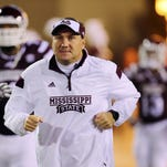 Mississippi State coach Dan Mullen leads the Bulldogs into 2015 looking to overcome the loss of 15 starters from last year's team.