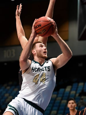 Sacramento State's big man Eric Stuteville shoots against Idahoh State in the first half of Tuesday's game the Big Sky Conference Basketball Championships at the Reno Events Center.