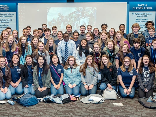 Students from the Blackman Collegiate Academy pose for a group photo with MTSU President Sidney A. McPhee, center in the second row, during their Feb. 2 stop in the Student Services and Admissions Center tour room.