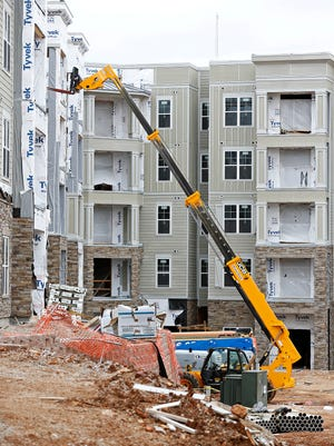 A worker fell to his death from a fifth floor balcony in the still under construction Aspen apartment complex in Springfield, Mo. on March 24, 2016.