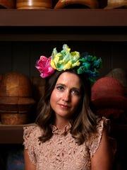 Julie Davis models one of Jenny Pfanenstiel's hats.