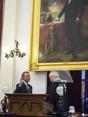 Gov. Phil Scott is sworn in by Chief Justice Paul Reiber at the Statehouse in Montpelier on Jan. 5.