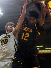 Iowa's Luka Garza and Grambling State's Bobby Jackson fight for a rebound during their game at Carver-Hawkeye Arena on Thursday, Nov. 16, 2017.