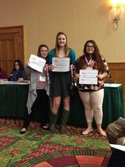 From left: Samantha Flickinger, Summer Schanberger and Cassandra Shermeyer pose with their certificates after winning gold in the advocacy category at the Students Taking Action with Recognition (STAR) statewide competition.
