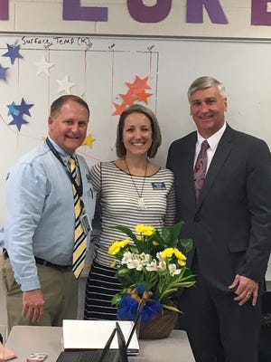 From left, Gulf Breeze High School Principal Danny Brothers, Santa Rosa Teacher of the Year Erin Cosky and Santa Rosa School District Superintendent Tim Wyrosdick stand for a photo Wednesday, Jan. 24, 2018, at the high school.