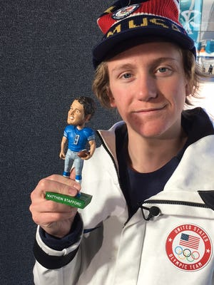 Snowboarder Red Gerard, who won the first Olympic gold medal for the U.S. at the 2018 Winter Games, holds bobblehead Matthew Stafford in Pyeongchang, South Korea.