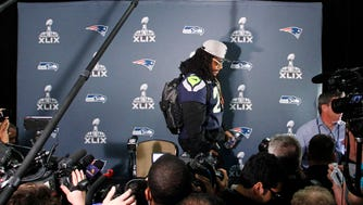 Seattle Seahawks running back Marshawn Lynch (24) walks away from reporters during the Seattle Seahawks press conference at Arizona Grand.