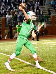 Novi quarterback Alec Bageris makes the throw in Friday's