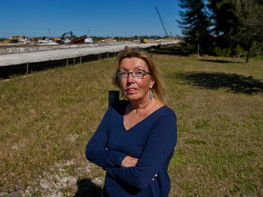 Cape Coral resident Kathy Bradley is one of a group of neighbors who have asked the county to build a $6 million berm to protect them from the traffic noise, safety on road widening project.  The ongoing project is visible from her backyard.