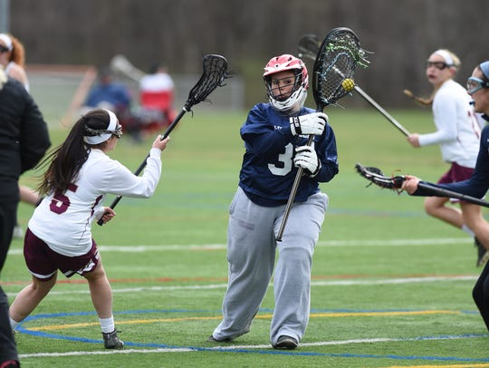 Wappingers lacrosse goalie Skylar Carpentieri defends