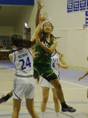 John F. Kennedy Islanders guard Irish Catibog drives into the Notre Dame Royals defense. Catabog finished with four points and the Royals earned a 74-32 home win on Friday, Dec. 11.