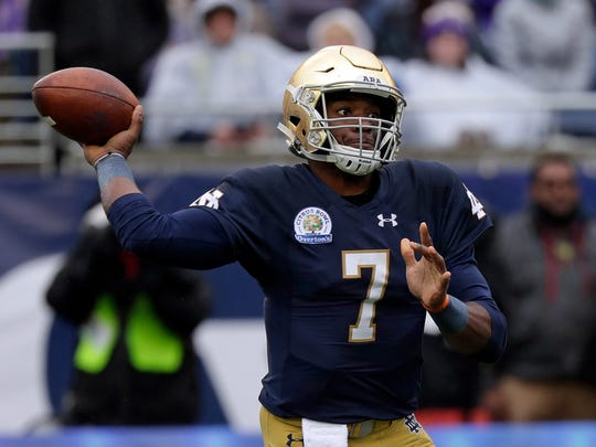 Notre Dame quarterback Brandon Wimbush (7) throws a pass against LSU during the first half of the Citrus Bowl on Monday. Wimbush played just five possessionsbefore being benched.
