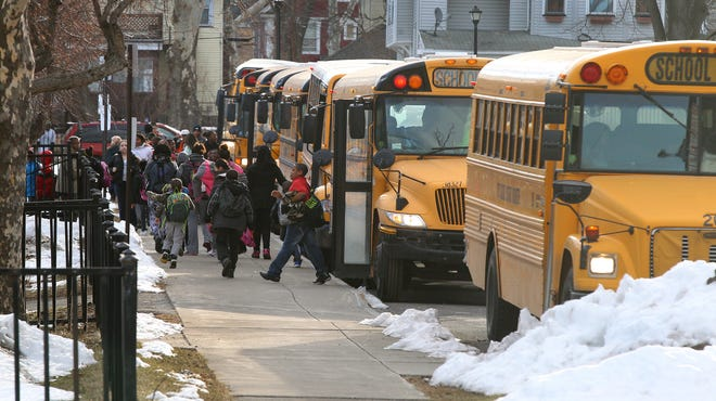 City students arrive at School 7 on Dewey Avenue in 2014. The students are bused to schools from different neighborhoods to accommodate the school choice initiative in the Rochester School District.