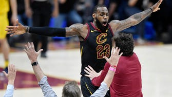 Cleveland Cavaliers forward LeBron James (23) celebrates his game-winning three-point basket in the fourth quarter against the Indiana Pacers in game five of the first round of the 2018 NBA Playoffs at Quicken Loans Arena.