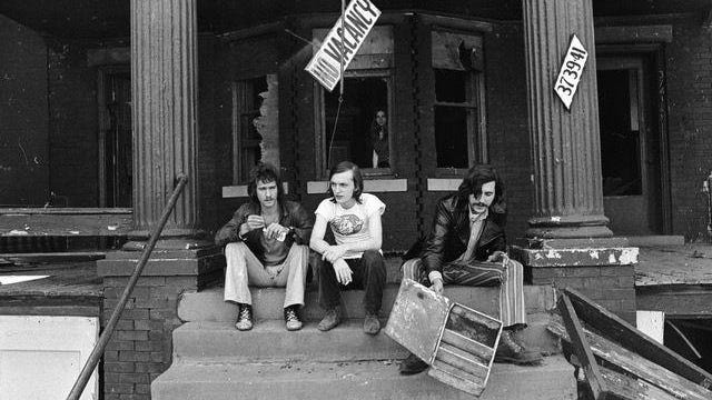 Creem staffers, from left, Barry Kramer, Dave Marsh and Lester Bangs, sit outside the magazine's office in Detroit circa 1970.