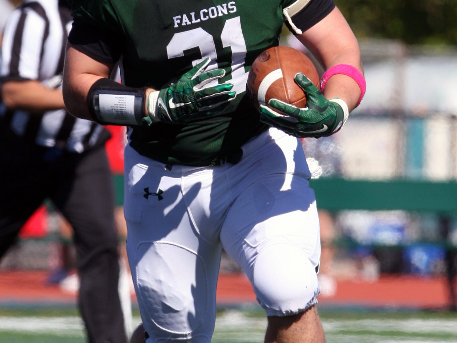 Action photos from the Perth Amboy High School at St. Joseph football game held at St. Joseph's new turf field in Metuhen on Saturday October 10, 2015. Here St. Joseph's # 31 Luke Yakley looks for running room during the 1st half of play.