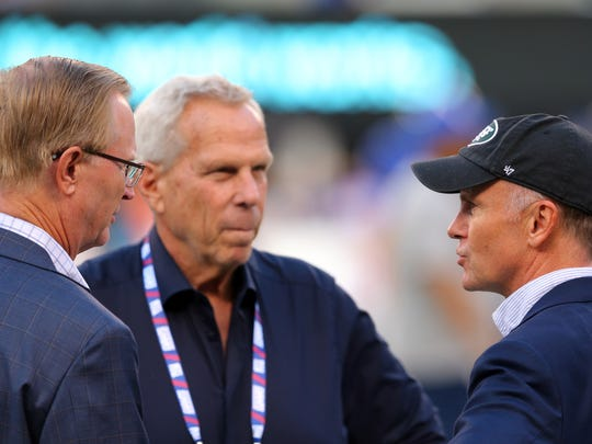 New York Jets acting owner Christopher Johnson talks to New York Giants co-owners John Mara (left) and Steve Tisch before a preseason game at MetLife Stadium.