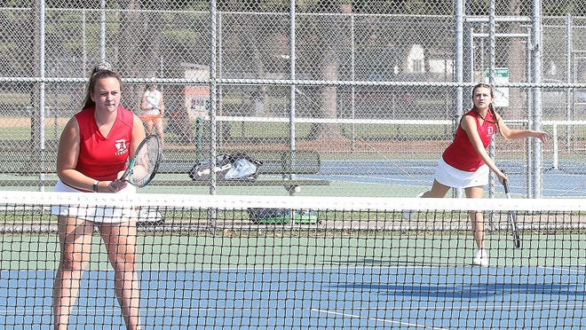 Dover's second doubles girls tennis team of Grace Williams and Hannah Graziani take on Green Thursday at Dover City Park.