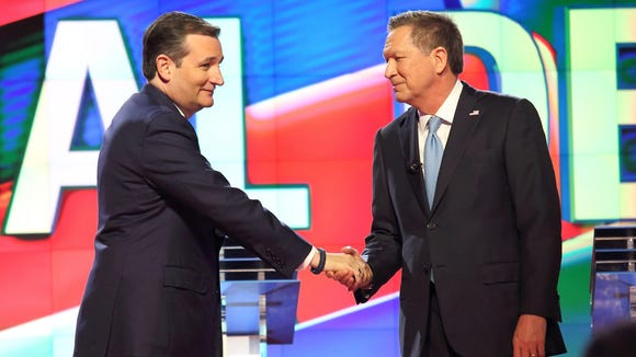 Ted Cruz and John Kasich shake hands during the Republican