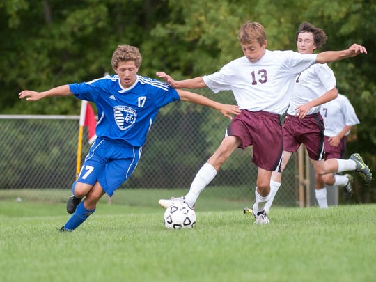Harper Creek's Logan Mays battles with Delton Kellogg's Carter Howland for the ball during game action Tuesday night.