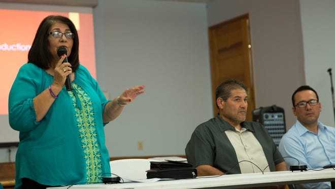 Mesilla Mayor Nora Barraza, left, Doña Ana County Assessor Andy Segovia, and Truth or Consequences City Manager Juan Fuentes explain the potential benefits and shortcomings of a colonia designation for Mesilla on Tuesday July 12, 2016.