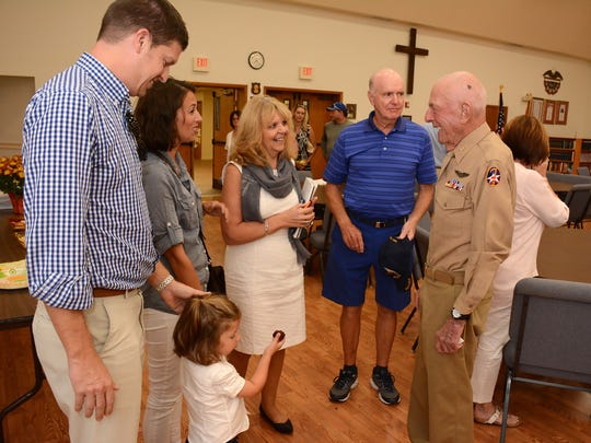 Jerry Yellin speaks with audience members after his talk. Yellin, who flew the last combat mission of World War II, spoke on the value of transcendental meditation to combat PTSD Monday evening at Faith Lutheran Church.