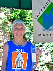 92-year-old Stasia Kowalski holds her first place ribbon at Lakeside Swim Club, Saturday, Jul. 29, 2017 in Louisville Ky.