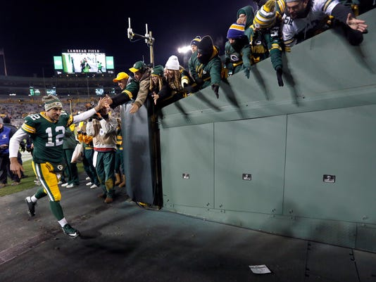Green Bay Packers quarterback Aaron Rodgers (12) runs to the locker room after an NFL football game against the Chicago Bears Sunday, Nov. 9, 2014, in Green Bay, Wis. The Packers won 55-14. (AP Photo/Mike Roemer)