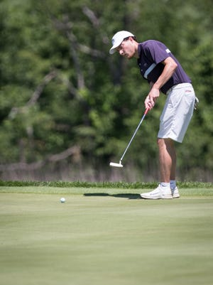 Tim Umphrey rolls a putt during Saturday's first round of the Worcester County Amateur at Kettle Brook Golf Course.