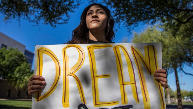 """Dreamer"" Fabiola Espinoza protests outside the Arizona Supreme Court in Phoenix during the hearing over dreamers' in-state tuition on April 2, 2018."
