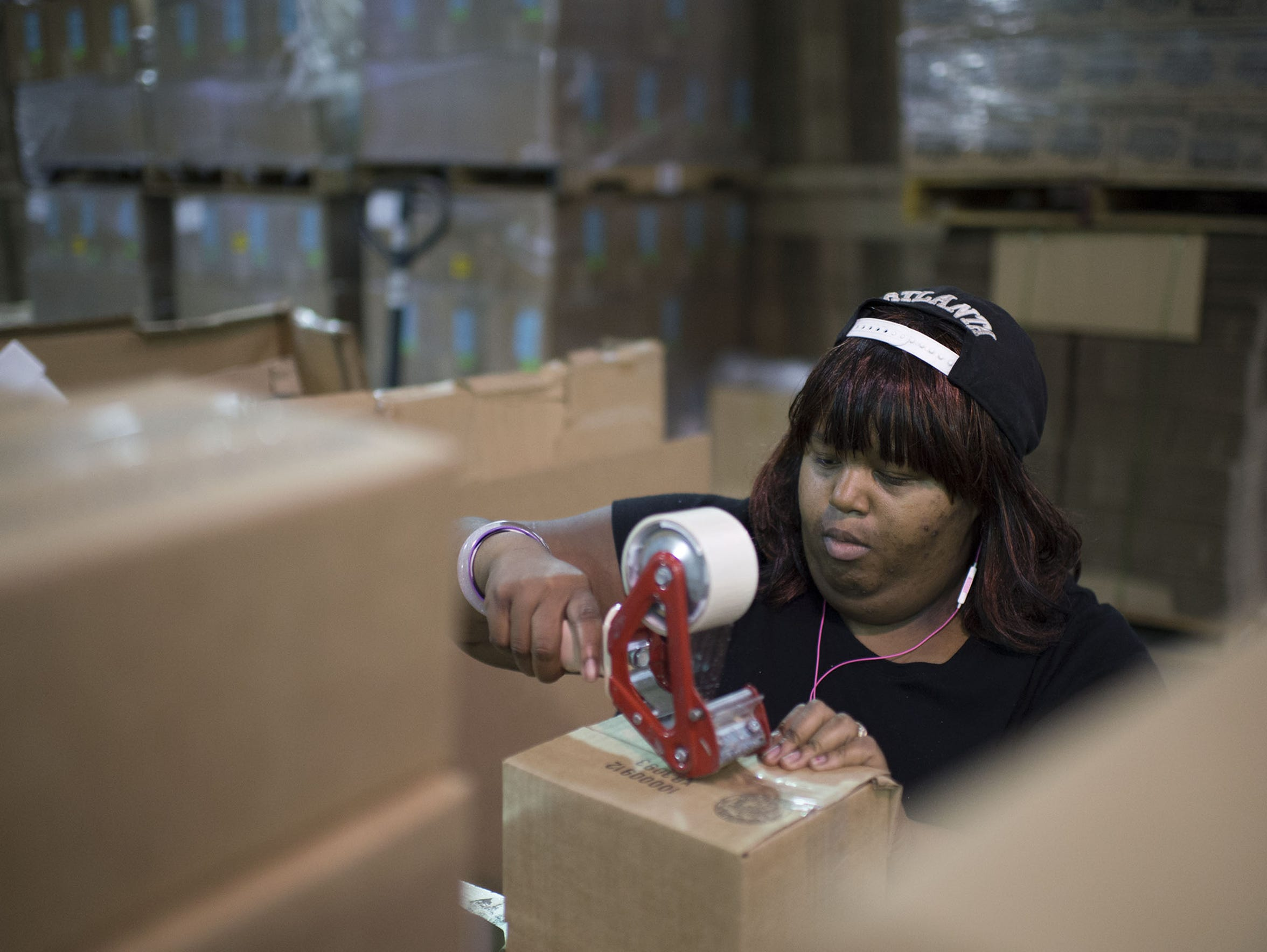 Topeka Robinson seals boxes at Easter Seals Wednesday,