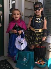 Anastasia Oganov, 2, left, and Alexa Oganov, 5, try