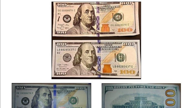 """A photo of real currency and the fake currency. The fake bills say """"For Motion Picture Use Only."""""""