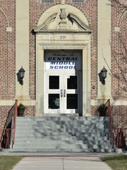 The entrance of Central Middle School in Dover is shown Tuesday. Two students have been charged after a gun was fired in a school restroom.