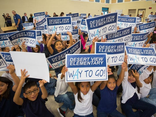 Sunland Park Desert View Elementary School students from the third to fifth grades hold up signs celebrating their success in being ranked first among all schools in New Mexico for growth in reading and math scores, Monday, August 29, 2016.
