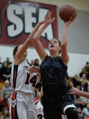 Bay Port junior Maddie Re, shown in a game at Pulaski earlier this month, has five double-doubles this season.