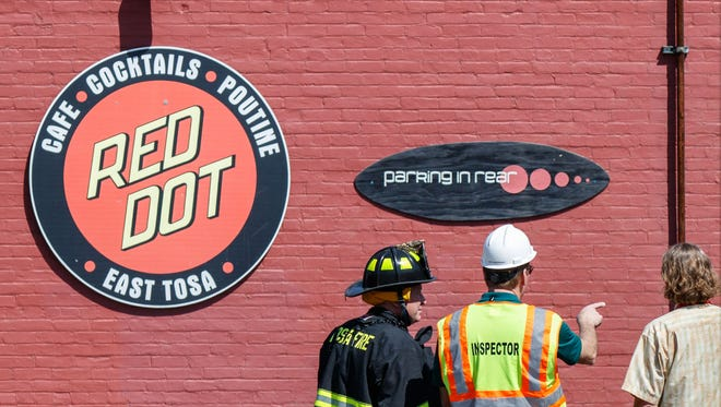 Emergency personnel inspect damage caused by a fire in the Red Dot bar/restaurant at 6715 W. North Ave. in Wauwatosa on Monday afternoon, May 7, 2018. The popular bar posted on July 19 there was plans to build on momentum of Red Dot.