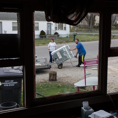 Carla King, left, helps Michael Parrish load up a washer