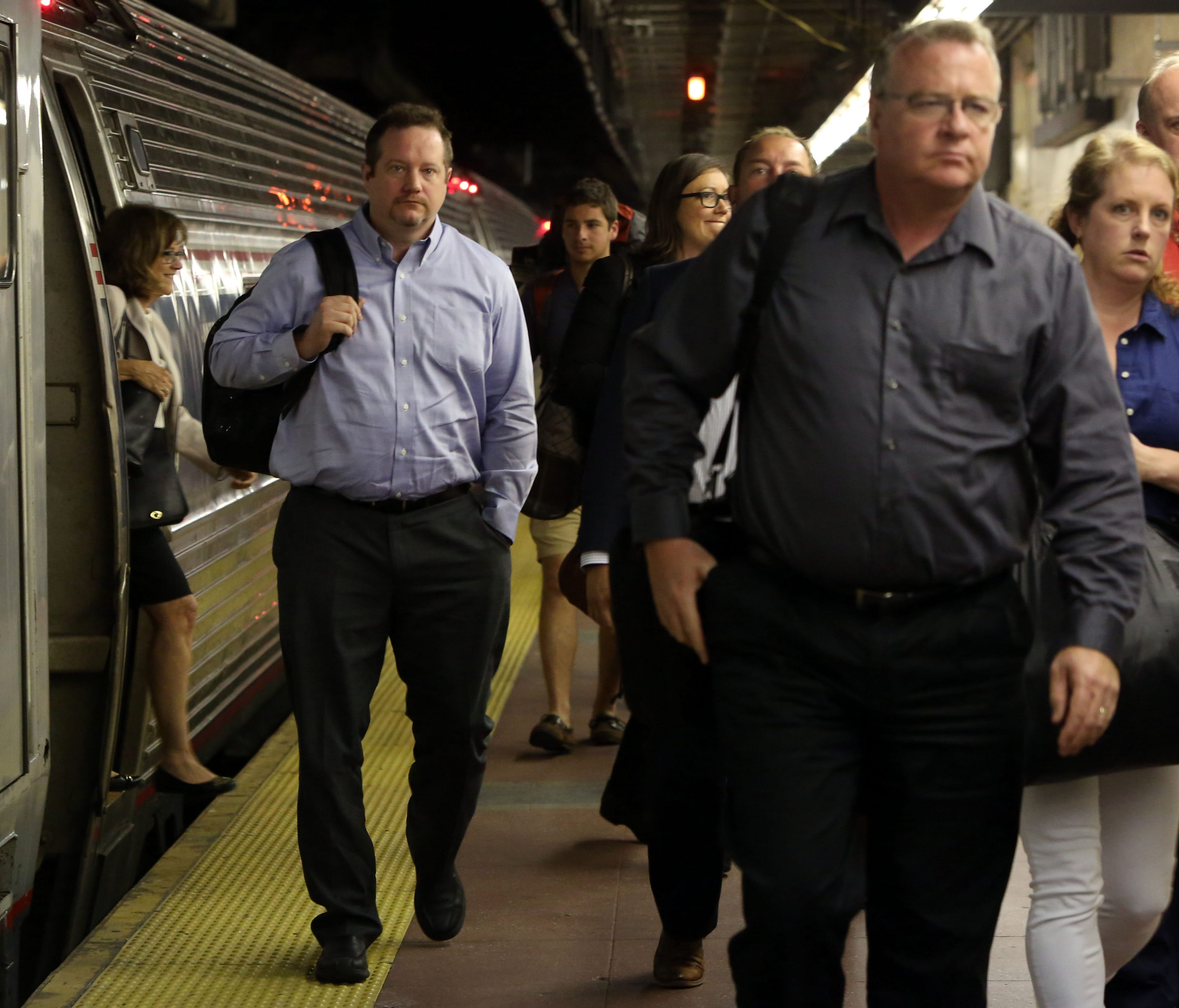Commuters aboard the 7:30 a.m. Amtrak train from Albany arrive at Grand Central Terminal in Manhattan July 10, 2017. Six Amtrak trains, three in and three out, will be routed into Grand Central Terminal each day as Amtrak performs eight week's worth