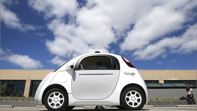 """This May 13, 2015, file photo, shows Google's new self-driving car during a demonstration at the Google campus in Mountain View, Calif. The federal government's highway safety agency agrees with Google: Computers that will control the cars of the future can be considered their driver. The redefinition of """"driver"""" is an important break for Google."""