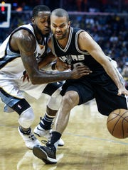 San Antonio Spurs guard Tony Parker (right) is a called