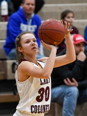 Henderson's Emilee Hope (30) spots up a three pointer as the Henderson County Lady Colonels play the South Warren Spartans at Henderson's Colonel Gym Friday, February 9, 2018.