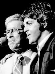 Roy Acuff, left, the King of Country Music, introduces Paul McCartney, the former Beatle, to a packed Grand Ole Opry House June 28, 1974. McCartney didn't perform, but preferred to wander around backstage with Chet Atkins and various Opry stars.