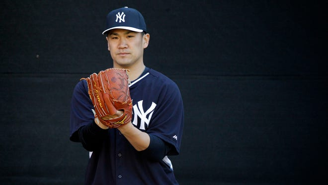 New York Yankees starting pitcher Masahiro Tanaka (19) works out at Steinbrenner Field.