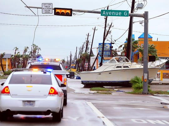 A boat sits in the road on Tuesday, Aug. 26, 2017 in Port Aransas, which was heavily damaged by Hurricane Harvey's high winds and rain.